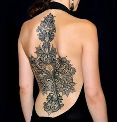 Intricate and sexy backpiece by Marco Manzo too.