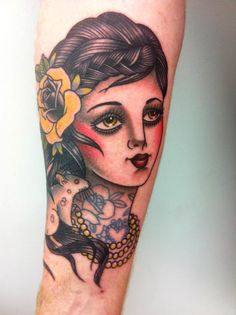 American Traditional of a woman with American Traditional tats + yellow rose :) by Leonie New.