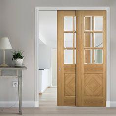 Deanta Twin Telescopic Pocket Kensington Oak Veneer Doors - Clear Bevelled Safety Glass - Prefinished.    #pocketdoors  #slidingdoors  #moderndoors
