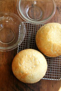 This is a no-knead bread that can be started at 4:00pm and turned out onto the dinner table at 7:00pm. It bakes in well-buttered pyrex bowls — there is no pre-heating of the baking vessels in this recipe — and it emerges golden and crisp without any steam pans or water spritzes. It is not artisan bread, and it's not trying to be. It is peasant bread, spongy and moist with a most-delectable buttery crust.
