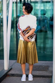 Street Style_ authentic sports zip thru jacket paired with metallic pleated midi skirt and worn back with white sneakers || Saved by Gabby Fincham ||