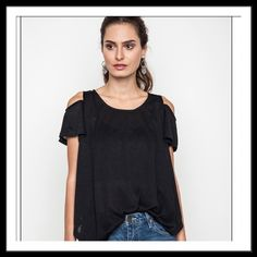 SALE Black Cold Shoulder Tee Black Cold Shoulder Tee! Great Trendy Tee! Please don't buy from this listing!! Send a comment indicating which size and I will make a listing for you! Thanks!! Tops