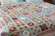 Inspired by the 'roses and castles' decorations found on canal narrowboats, this pretty rose square motif makes a beautiful blanket…