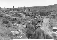 Stretcher bearers of the Battalion Headquarters and an ammunition fatigue party, near Clapham Junction in the Ypres Sector, returning along a communication trench from the new front line. Wounds Nursing, Ww1 Battles, Battle Of The Somme, Flanders Field, Lest We Forget, Military Personnel, World War I, Wwi, Black Watches
