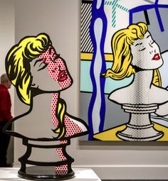 "RoyLichtenstein - Nude With Bust"" Sculpture, right and detail of ""Woman: Sunlight, Moonlight"" left, included in the Roy Lichtenstein Retrospective at the National Gallery of Art in Washington, DC."