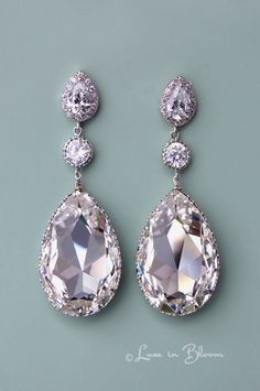 Elegant and sophisticated clear Swarovski crystal chandelier earrings are a glamorous accessory. By Luxe in Bloom