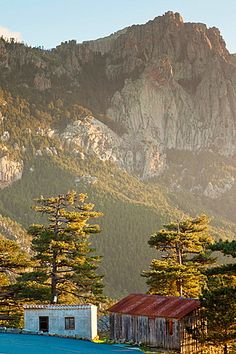 France, Corsica, Corse-du-Sud Department, La Alta Rocca Region, Col de Bavella pass, Aiguilles de Bavella peaks, small mountain huts