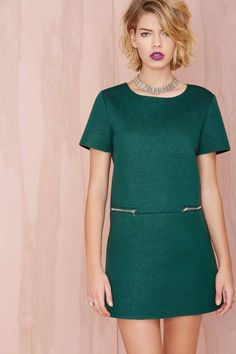 We're into all things mod right now and this hunter green dress would look perfect with a pair of chelsea boots and exaggerated eye make up.