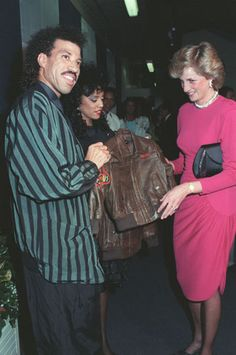 Lionel Richie and his wife Brenda present Britain's Princess Diana with two leather jackets for her children, Princes William and Harry, at Richie's final Wembley concert, in London, May 6, 1987. Credit: AP Photo/Gill Allen