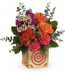 """Add some extra special sparkle to their birthday with this grand gift! Hand-delivered in a shimmering golden cube with intricate cutouts, this colorful bouquet will make their birthday week wonderful. Later, they can remove the pretty magenta liner and golden """"happy birthday"""" pick and enjoy the cube as a pretty candleholder!"""