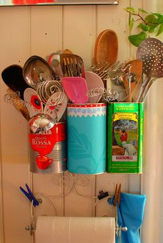 A great example of a high Playfulness value in action: vintage-style cans repurposed as wall-hanging kitchen utensil holders. Choices ran the gamut from pink silicon to retro with posies to olivewood and curlicued metal. An easy, laid-back, fun assortment. | commentary via The Voice Bureau | AbbyKerr.com