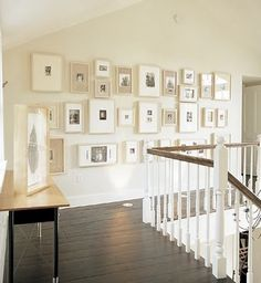 Wall picture gallery. looks like the top of our staircase