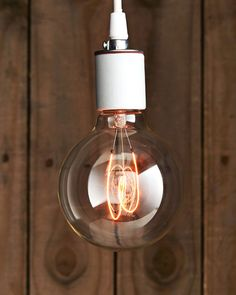 Sklo Carbon Filament Light Bulb - Globe 'K-95': Although these bulbs come in standard shapes and screw bases, their carbon or tungsten filaments are completely unique