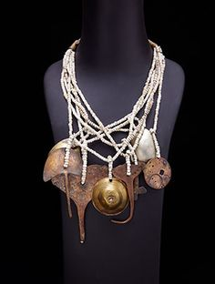 "www.africaandbeyond.com. ""Curandera Necklace"" by Melanie, with Mayan Charms of Copper, Brass, and Glass Beads. Glass beads hung with ancient Mayan healing instruments, or ""Curandera"" charms made of bronze and copper."