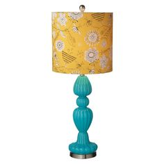 Metal table lamp with a turned glass column and floral-print shade.  Product: Table lampConstruction Material: G...