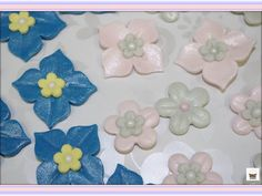 Homemade fondant flowers for the cupcakes! Visit Omg! Cupcakes athttps://www.facebook.com/OmgCupcakesGP