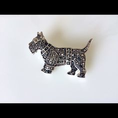 """⚜Vintage Marcasite Scottish Terrier Pin. Dress it up or wear it with jeans...this wonderfully intricate Scotty dog pin is made of silver tone metal and covered with a variety of marcasite stones. Marcasite used in jewelry is actually made of Pyrite, often called """"Fool's Gold"""" because it is more stable, and less likely to crumble. It's history goes back to the Incas, early Greeks and Romans, but it began to gain popularity in the 1800's.This Scotty is 1"""" tall x 1 3/4"""" long, and is in…"""