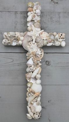 I know I can find enough seashells to do this with...this would be so cute and pretty in our guest bathroom! ~~ seashell crafts | ArtSea Chic: GIVEAWAY: My Honeypickles Seashell Cross