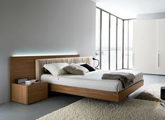 Contemporary bedgroup set with fabric headboard in Italian walnut. High end luxury style bedroom set. The standard bedroom set of the contemporary collection consists of a King or Queen size platform bed, two nightstands, a dresser. You can easily customize your own furniture set the way you like, a...