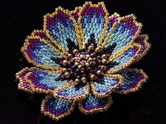Cosmos Bead corsage Knitted with glitter metallic beads . Add an exotic atmosphere just to suit your dark attire! It is a unique costume jewelry that drifts gorgeous . Beaded Flowers Patterns, Beaded Jewelry Patterns, Beading Patterns, Seed Bead Flowers, French Beaded Flowers, Beadwork Designs, Peyote Beading, Beaded Brooch, Brooch Pin