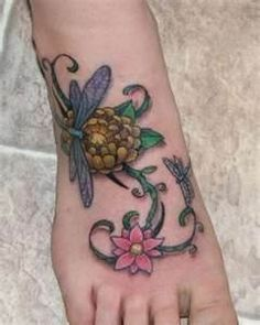 Dragonflies with flowers on foot - cute-tattoo