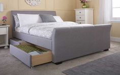Classic, timeless designer lines create a beautiful kingsize bed frame finished in a sophisticated grey hopsack fabric. 4 roll out drawers complete this versatile bed frame. FREE  Delivery.