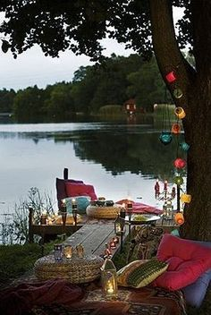 outdoor living--- this reminds me of sitting on the dock at Lodi Lake.. We've all had a picnic here, an after dinner moment, or an arranged  simple setting , like pictured above. Ahhh, Lodi.