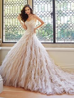 Sophia Tolli - Tulle sweetheart wedding dress with chapel train, just for the frill of it, Marlene demands your attention in frothy layers of misty tulle. Final Sale