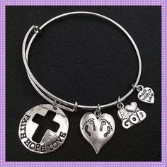 Silver Bangle Bracelet, Faith-Hope-Love BEAUTIFUL Silver Alloy Bangle Bracelet with charms. Biggest round charm has cross cut-out with inscription FAITH-HOPE-LOVE, heart shaped charm with two sets of foot prints, I ❤️God Charm & small heart shaped charm with inscription Made with Love.BUY ONE FOR $15 OR TWO FOR $25PRICE IS FIRM Boutique Jewelry Bracelets