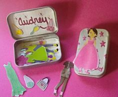 Paper doll to-go box made from an Altoids tin and stickers glued to magnets.  -juliajameslee