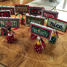 Cute Kathy Schenkel words finished boxed on her painted blocks. These are a must to set around the decorations during the Holidays.
