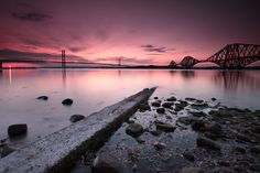 """Another shot of the Forth bridges at sunset. Shot from the South Queensferry side of the Firth of Forth.  Canon 50D Sigma 10-20mm Focal Length 10mm Aperture 11.0 Exposure 30 seconds ISO 100 Hitech Reverse Neutral Density filter  Best viewed large on black. Click on the photo or hit the """"L"""" key on your keyboard."""