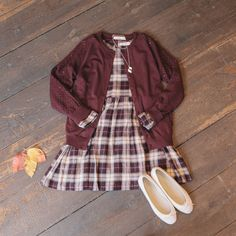 Punching sleeve knit cardigan & check baby doll dress:  www.oliveclothing.com