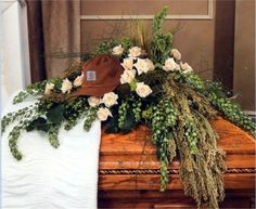 This unique casket spray arrangement beautifully reflects your deepest sympathies, and is filled with an ample amount of luscious greenery and fresh, soft-colored roses. Casket Flowers, Grave Flowers, Cemetery Flowers, Funeral Flowers, Funeral Floral Arrangements, Flower Arrangements, Flowers For Men, David Flowers, Funeral Caskets