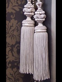 PASSEMENTERIE : Thė French art of tassels cording, and trim. Here, the perfect set of corded tassels in an elegant shade of platinum, to use as tie-backs for curtains.