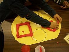 Play doh shape placemats! Keeps table clean AND practicing shape recognition AND coil rolling AND...