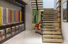 A child's dream come true: Their very own home sweet shop stocked with cascading candy dispensers