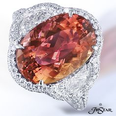 Imperial Topaz and Diamonds Platinum Ring Center: Oval Imperial Topaz 7.56 ct. (Brazil) Diamonds: 2.50 ct. tw. (Half Moons, & Round)
