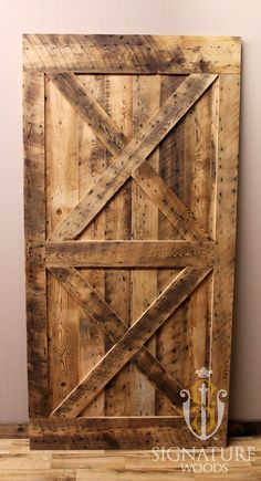 Sliding Style Barn Door made out of reclaimed barn wood. This door was constructed specifically out of roof boards, that is why there are so many little holes in it.