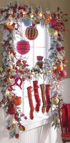 colorful christmas window decoration -- I love the skinny stockings! Noel Christmas, All Things Christmas, Winter Christmas, Christmas Wreaths, Christmas Crafts, Whimsical Christmas, Christmas Kitchen, Christmas Windows, Christmas Christmas