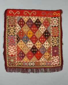 Usbekistan embroidered mirror cover with finely worked diamond and cruciform field. 27 x 27 (few tiny holes in wool header). Excellent. $3,120