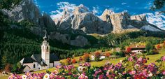 The Dolomites Mountains are a place where days go by in piece, a true natural heaven, a rich show of the environment with rocks, woods and pastures. This landscape is featured in this wonderful panoramic jigsaw puzzle, which is 13,200 Pieces!