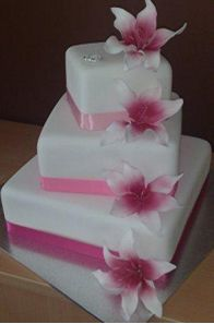 Geometric square wedding cake with ribbons and flowers