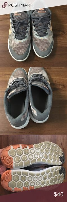 Nike running shoes Salmon and grey Nike fit running shoes! Comfortable and super cute! Some pulling in the heal from wearing on turf a few times, as well as the orangey color on the bottom. In great condition! Nike Shoes Sneakers