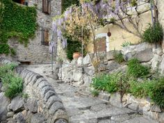 A beautiful hillside village with little cobbled streets - Thought to be one of the sunniest villages in France, Eus can also boast of being amongst the… Hillside Village, Destinations, Sites Touristiques, Station Balnéaire, Beaux Villages, Parcs, France Travel, Travel Guide, Spain