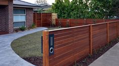 Horizontal merbau front feature fence with exposed posts, capping and letterbox installed