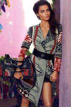 Amazing combination of Aztec black, red and white prints on a coat and Hand held bag is a good finding for winter 2015.