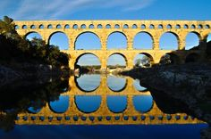 Pont du Gard, Remoulins, France  This bridge was built between 40 and 60 AD. It is built to cross the Gardon river gorge in southern France. It main purpose was romans to carry water from the spring in Uzes, France to the colony in the today known city Nimes.