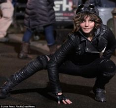 Kit-ted out: But she later transformed into a leather clad younger version of Catwoman as filming began