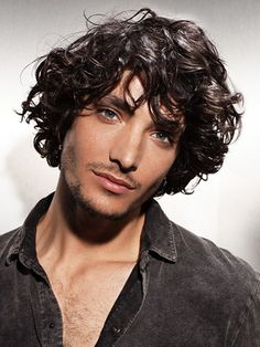 Men's curly shag hairstyle